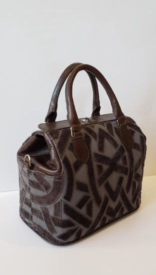 Lucque handbag that is brown with harringbone pattern